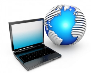 laptop_with_globe_displaying_technology_stock_photo